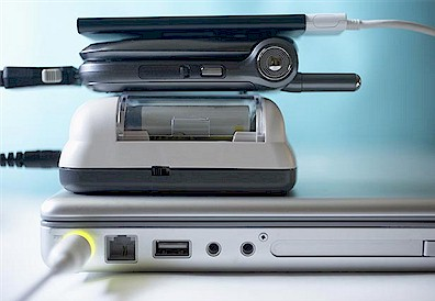 chargers-electronics-travel-items-carry-on.jpg (28160 bytes)